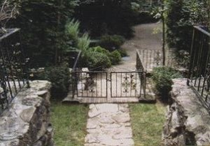 Fence and Stone Driveway area
